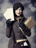 Young postman girl with mail. Photo in old color style with boke — Photo