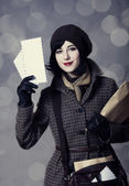 Young postman girl with mail. Photo in old color style with boke — Stockfoto