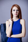 Redhead girl with bag — Stock Photo