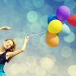 Redhead girl with colour balloons — Stock Photo #16689245