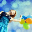Redhead girl with colour balloons — Stock Photo #16689277