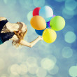 Redhead girl with colour balloons — Stock Photo #16689321