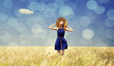 Redhead girl at spring wheat field. — Stock Photo