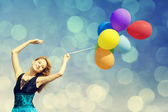 Redhead girl with colour balloons — Stock Photo