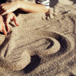 Stock Photo: Drawing heart at sand.