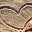 Drawing heart at sand. — Stock Photo