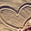Drawing heart at sand. — Stock Photo #16791153