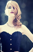 Fashion women in corset. Photo with backlight. — Stock Photo