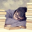 The young tired student with the books isolated. — Stock Photo #17157405