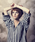Style girl in shirt at studio. — Stock Photo