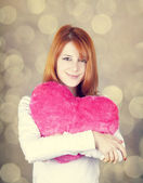 Portrait of red-haired girl with toy heart. — Stock Photo