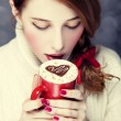 Stock Photo: Redhead girl with coffe. St. Valentine Day