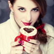 Redhead girl with coffe. St. Valentine Day — Stock Photo