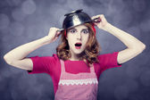 Redhead housewife with colander over head — Stock Photo