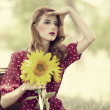 Redhead girl with sunflower at outdoor. — Stock Photo