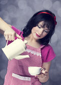Brunette women with teapot and cup. — Stock Photo