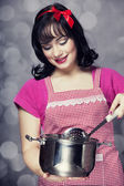 Brunette housewife with soup ladle — Stock Photo
