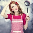 Redhead housewife with soup ladle - Stock Photo