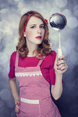 Redhead housewife with soup ladle — Stock Photo