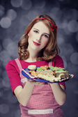 Redhead women with cookies — Stock Photo