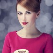 Redhead girl with coffee cup. St. Valentine — Stock Photo