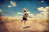 Red-head girl with guitar. Photo in old image style. — Stock Photo