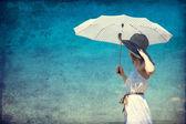 Redhead girl with umbrella at outdoor. — Foto de Stock