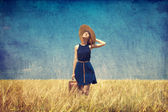 Lonely girl with suitcase at country. Photo in old color image s — Stock Photo