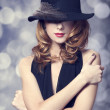 Portrait of beautiful redhead girl in hat. — Stock Photo