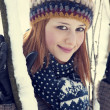 Beautiful young red-haired woman in winter park — Stock Photo #19005943