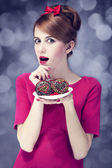 Redhead girl with cakes for. St. Valentine Day. — Stock Photo