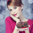 Redhead girl with cake for St. Valentine Day. - Stock Photo