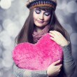 Beautiful brunette girl with toy heart. Photo for st. Valentine — Stockfoto