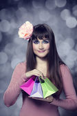 Beautifu brunette girl with present boxes — Stock Photo