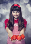Brunette housewife wtih tomatos — Stock Photo