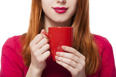 Red-haired girl with cup. — Stock Photo