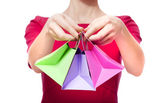 Women in red dress with little shopping bags — Stock Photo