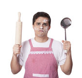 Cooking man with kitchenware over white bakcground — Stock Photo