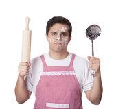 Cooking man with kitchenware over white bakcground — Stock Photo