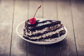 Cherry cake. Photo in old vintage color image style. Focus on ch — Stock Photo