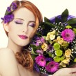 Redhead girl with flowers, isolated. — Stock Photo #21178361