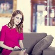 Redhead woman with tablet in interior — Stock Photo #21178395
