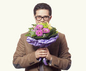 Man with flowers in hand — Stock Photo