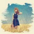Lonely girl with suitcase at country. Photo in old paint color i — Stock Photo #21259617