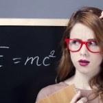 Surprised redhead student near blackboard. — Stock Photo