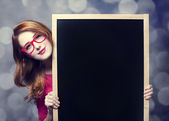 Redhead student with blackboard. — Stock Photo