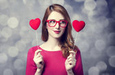 Beautiful redhead girl with two hearts. — Stock Photo