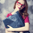 Smiling hipster girl with bag. — Stock Photo