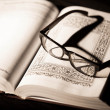 Book and Glasses. Vintage style — Stock Photo