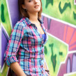 Style teen girl standing near graffiti wall. — Stok fotoğraf